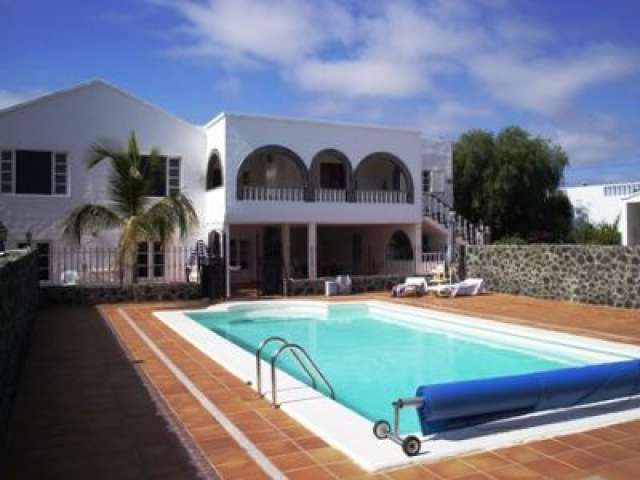 2 bedroom apartment in large Canarian villa in Playa Honda, Lanzarote. Excellent views, heated pool, spacious, free airport pick ups, discounted car hire, same price all year round.